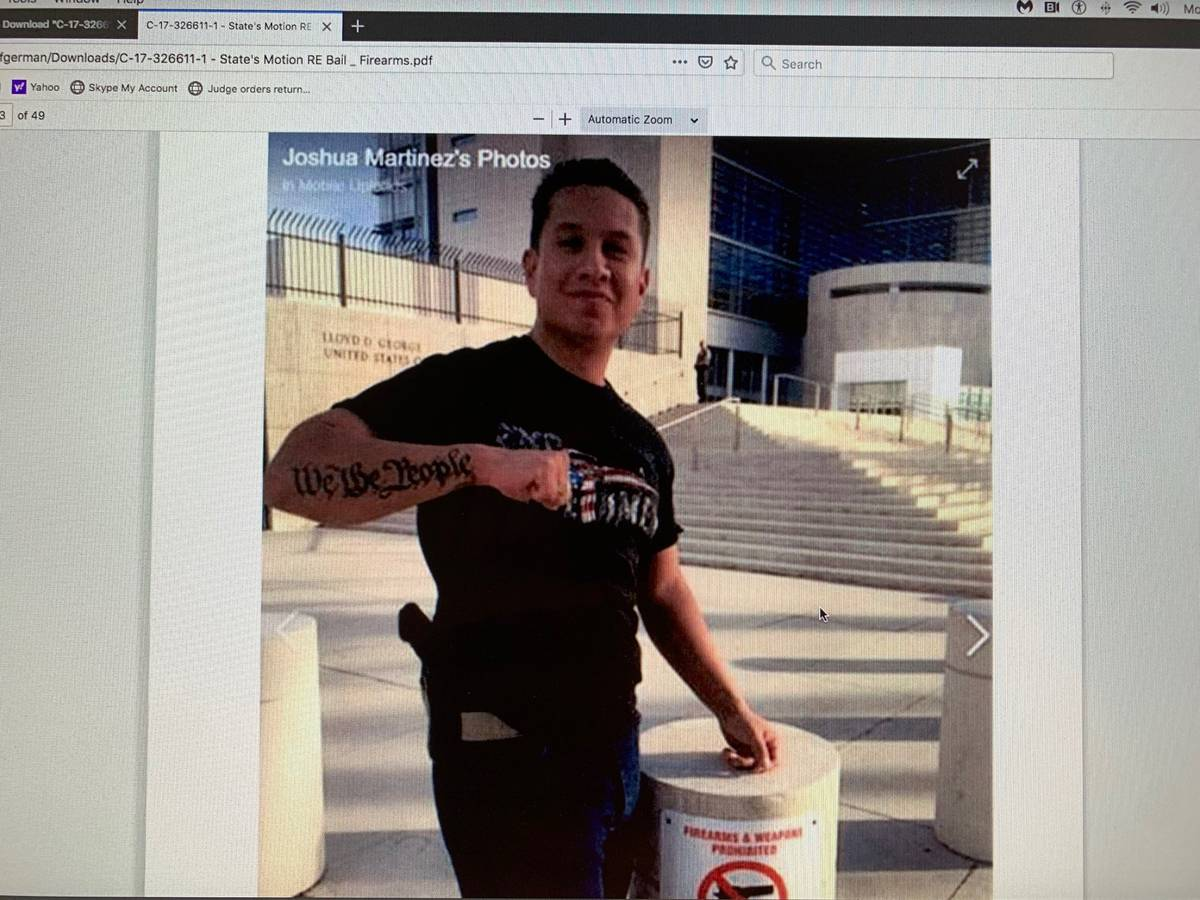 Joshua Martinez standing outside the Lloyd D. George U.S. Courthouse. The photo appears as exhi ...