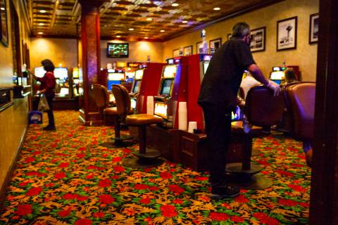 A worker sanitizes a gaming area at the El Cortez on Thursday, June 4, 2020. (Chase Stevens/Las ...