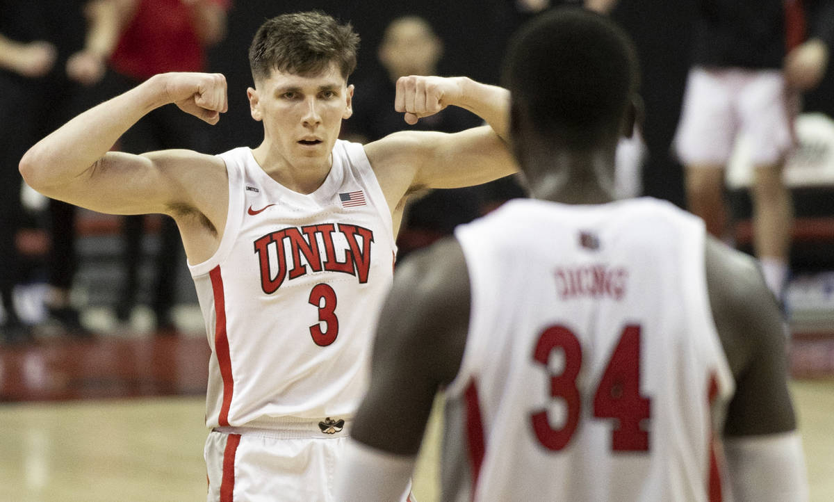 UNLV Rebels guard Caleb Grill (3) celebrates with UNLV Rebels forward Cheikh Mbacke Diong (34) ...