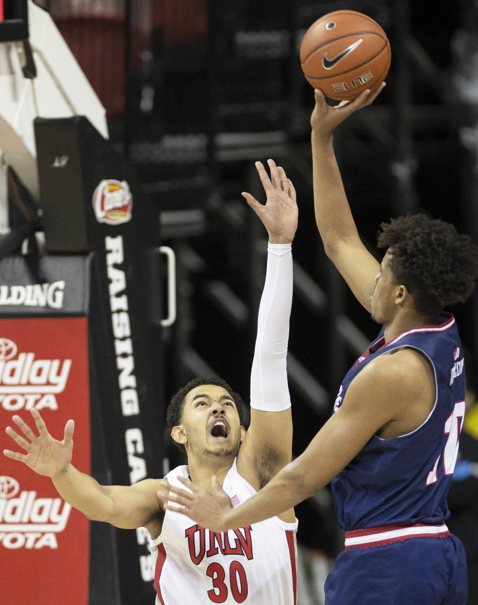 UNLV Rebels forward Devin Tillis (30) extends to try and block the shot of Fresno State Bulldog ...