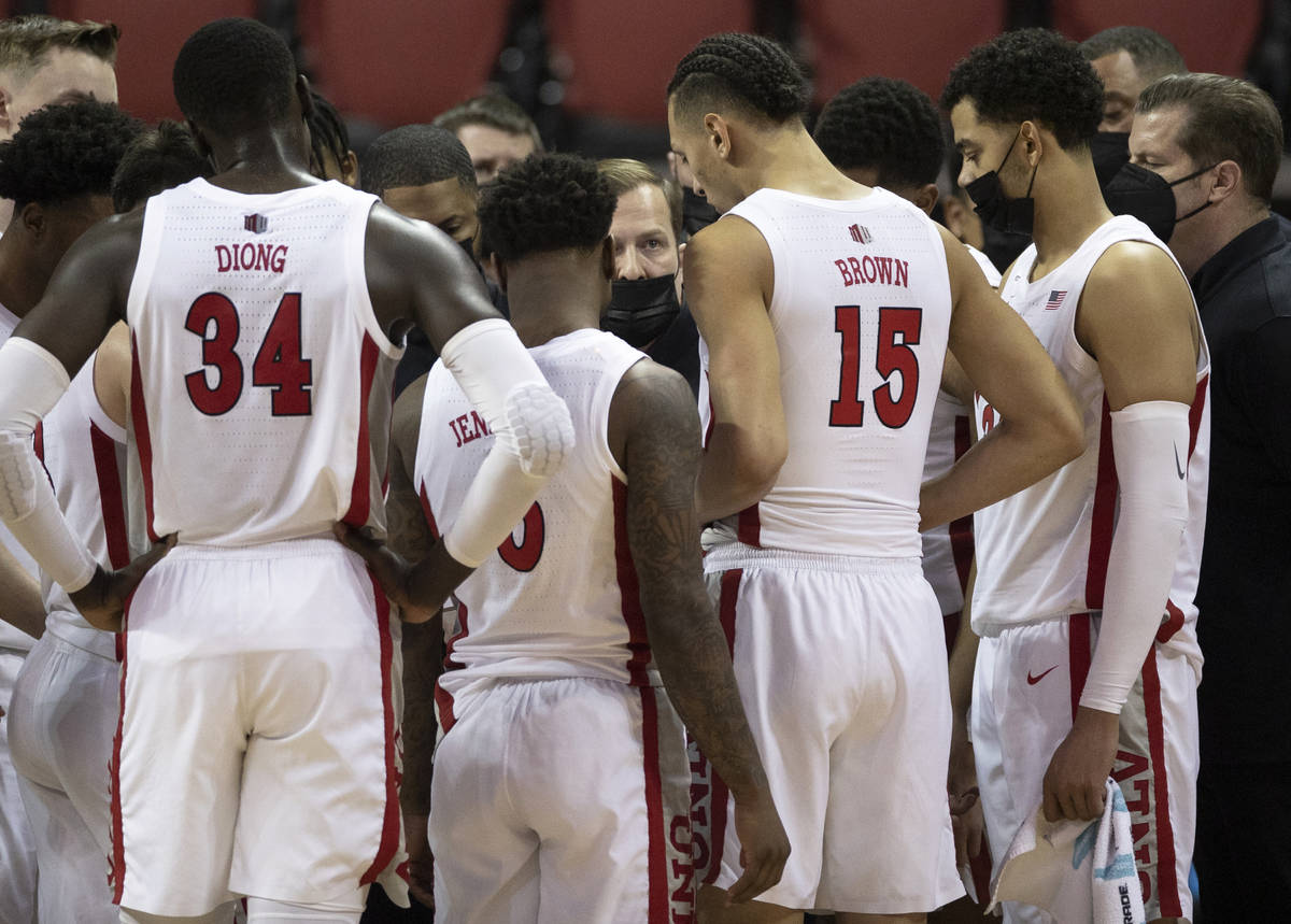 UNLV Rebels head coach T.J. Otzelberger directs his team during a time out in the second half d ...
