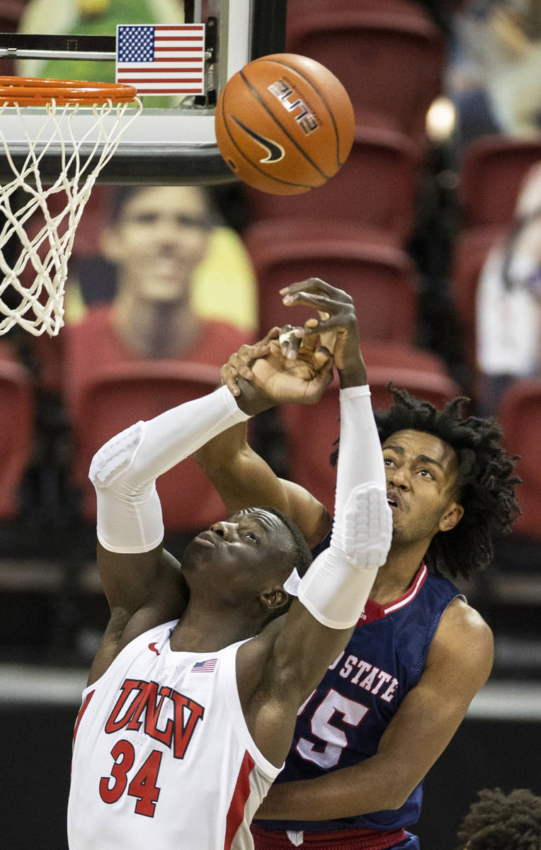 UNLV Rebels forward Cheikh Mbacke Diong (34) fights for a loose ball with Fresno State Bulldogs ...
