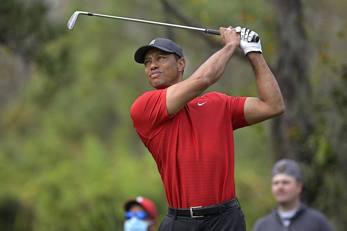 FILE - Tiger Woods watches his tee shot on the fourth hole during the final round of the PNC Ch ...