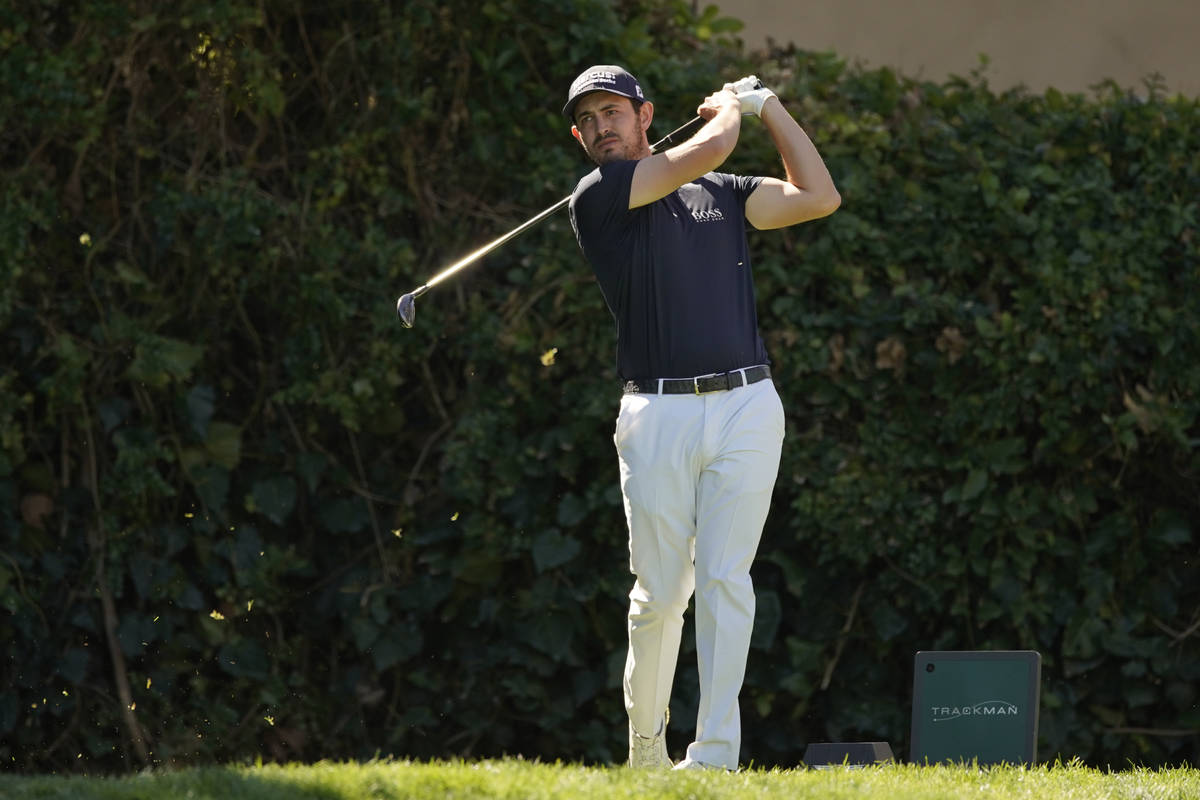 Patrick Cantlay tees off on the seventh hole during the final round of the Genesis Invitational ...
