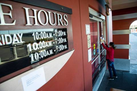 An employee who declined to give their name puts up a notice about the closure of Fry's Electro ...