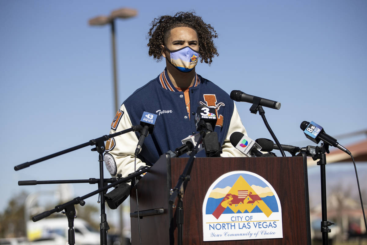 Football player Trevor Moser, 17, a senior a Legacy High School, is interviewed during a press ...