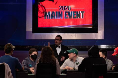 WSOP vice president Jack Effel talks to the players at the final table of the U.S. portion of t ...