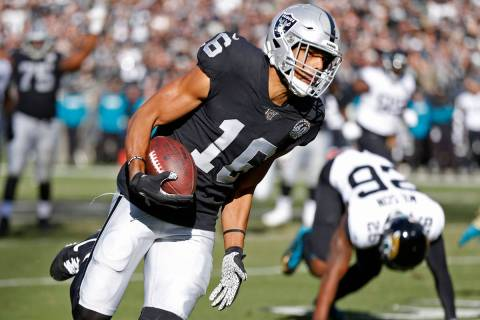 Oakland Raiders wide receiver Tyrell Williams runs with the ball for a touchdown past Jacksonvi ...