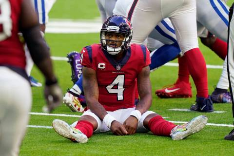 Houston Texans quarterback Deshaun Watson (4) sits on the turf after losing a fumble to the Ind ...