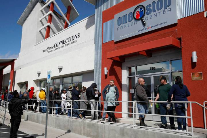 In this March 17, 2020, file photo, people wait in line for help with unemployment benefits at ...
