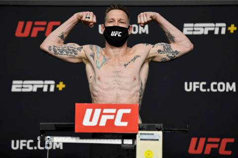 Kevin Croom poses on the scale during the UFC weigh-in at UFC APEX on February 26, 2021 in Las ...