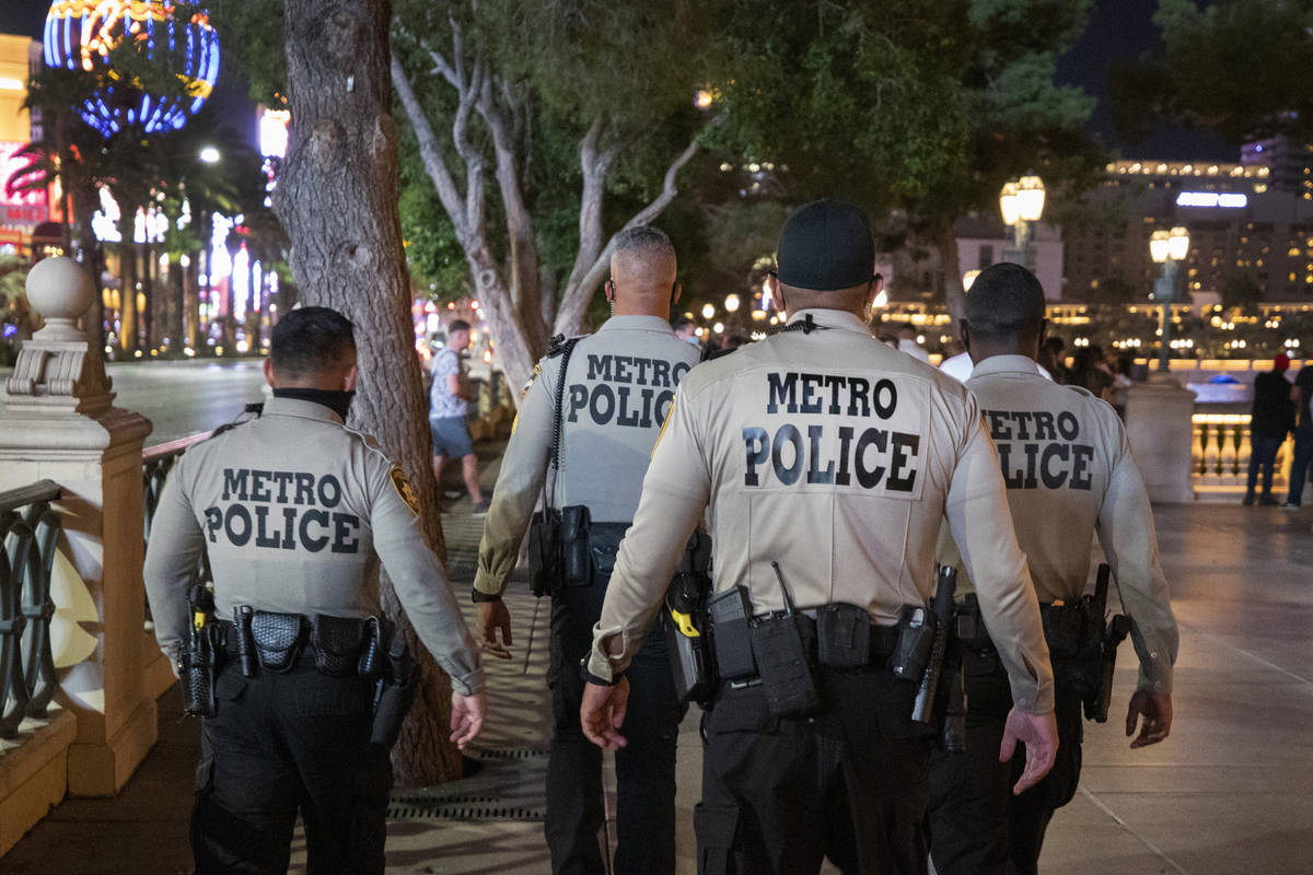 Las Vegas Metro Police are seen patrolling near the Bellagio hotel and casino fountains on the ...