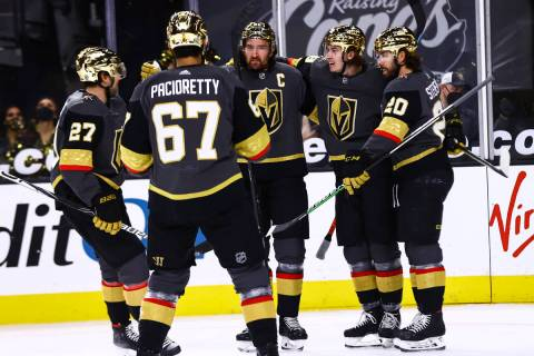Golden Knights center Cody Glass, fourth from left, celebrates his goal against the Minnesota W ...