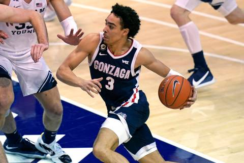 Gonzaga guard Andrew Nembhard (3) drives to the basket in the second half during an NCAA colleg ...