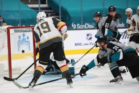 Vegas Golden Knights right wing Reilly Smith (19) scores a goal as San Jose Sharks center Logan ...
