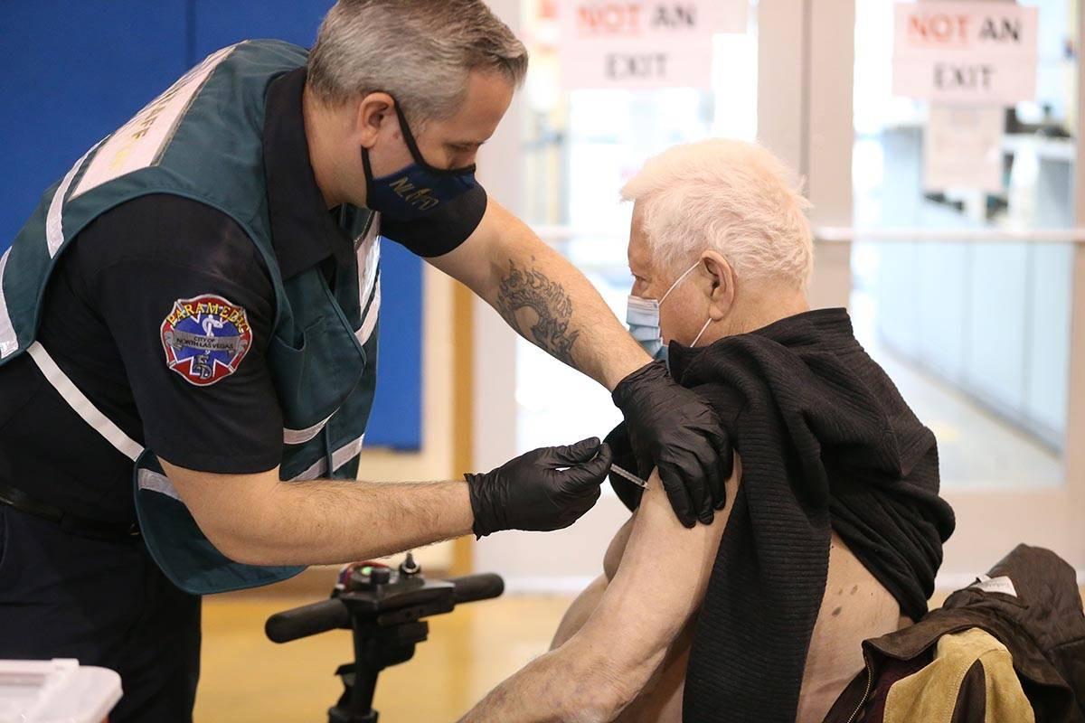 Richard Lober, 79, receives the COVID-19 vaccine from Nathan Van Wingerden, paramedic for the N ...