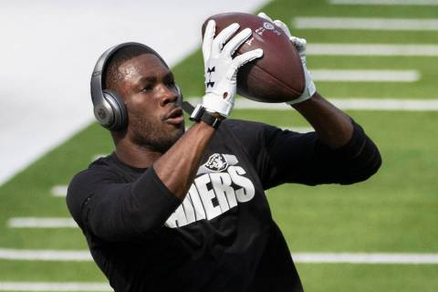 Las Vegas Raiders wide receiver Nelson Agholor (15) warms up before the start of an NFL footbal ...