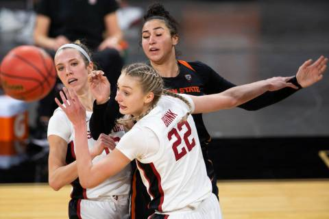 Stanford Cardinal guard Lexie Hull (12), left, and forward Cameron Brink (22) fall back after a ...