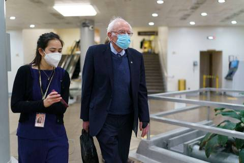 Sen. Bernie Sanders, I-Vt., chair of the Senate Budget Committee, returns to his office while t ...