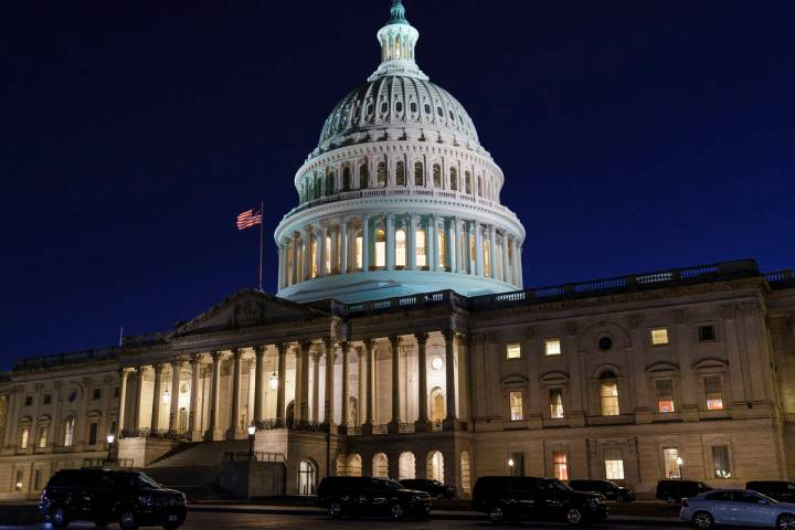 The Capitol is seen at dusk as work in the Senate is stalled on the Democrats' $1.9 trillion CO ...