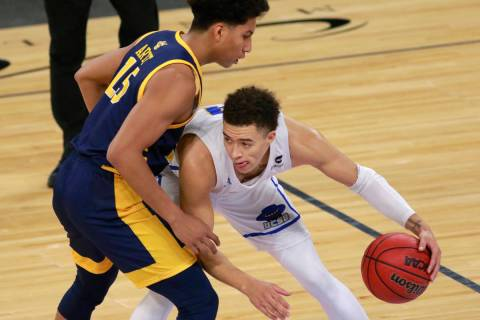 UC Santa Barbara's JaQuori McLaughlin (3) keeps possession of the ball from UC Irvine's Jeron A ...