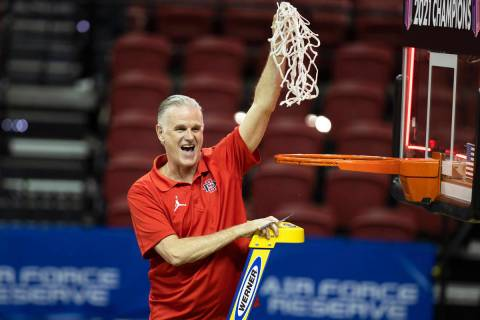 San Diego State Aztecs head coach Brian Dutcher celebrates after winning the Mountain West conf ...