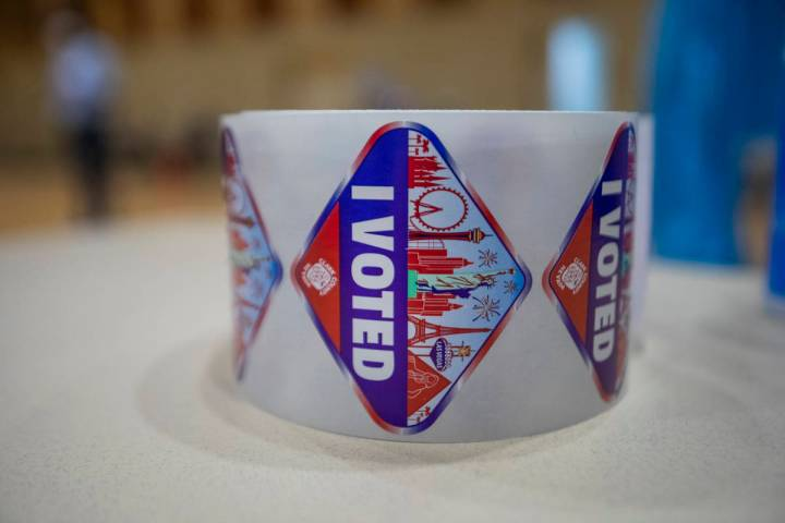 Stickers are seen at the Historic Fifth Street School polling station nearing the station's clo ...