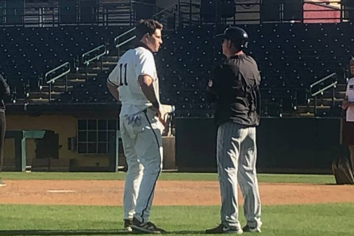 Kade Higgins, left, shares a moment with his father, Kevin, UNLV's associate baseball coach, af ...