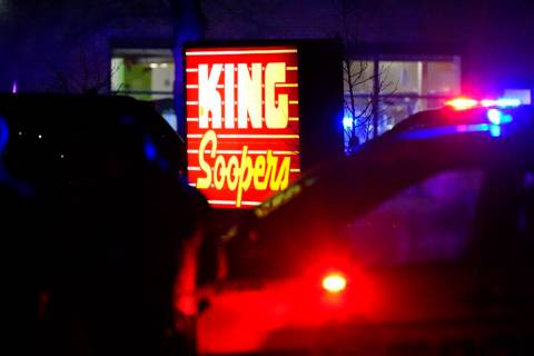Police stand guard outside a King Soopers grocery store where authorities say multiple people w ...