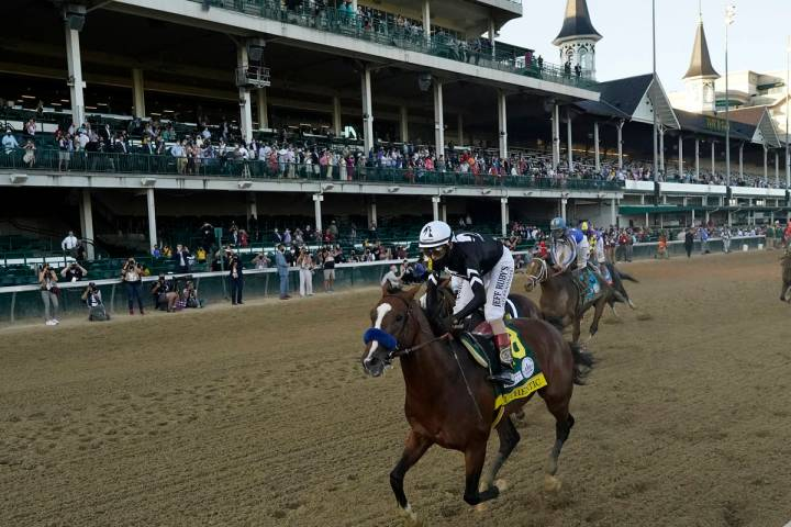 Jockey John Velazquez riding Authentic, wins the 146th running of the Kentucky Derby at Churchi ...