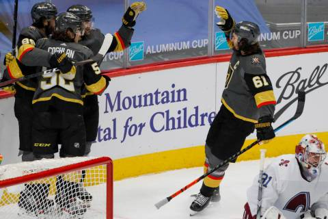 Vegas Golden Knights right wing Alex Tuch (89) and defenseman Dylan Coghlan (52) hug Golden Kni ...