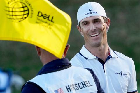 Billy Horschel is congratulated by his caddie on the 17th green after Horschel won the Dell Tec ...