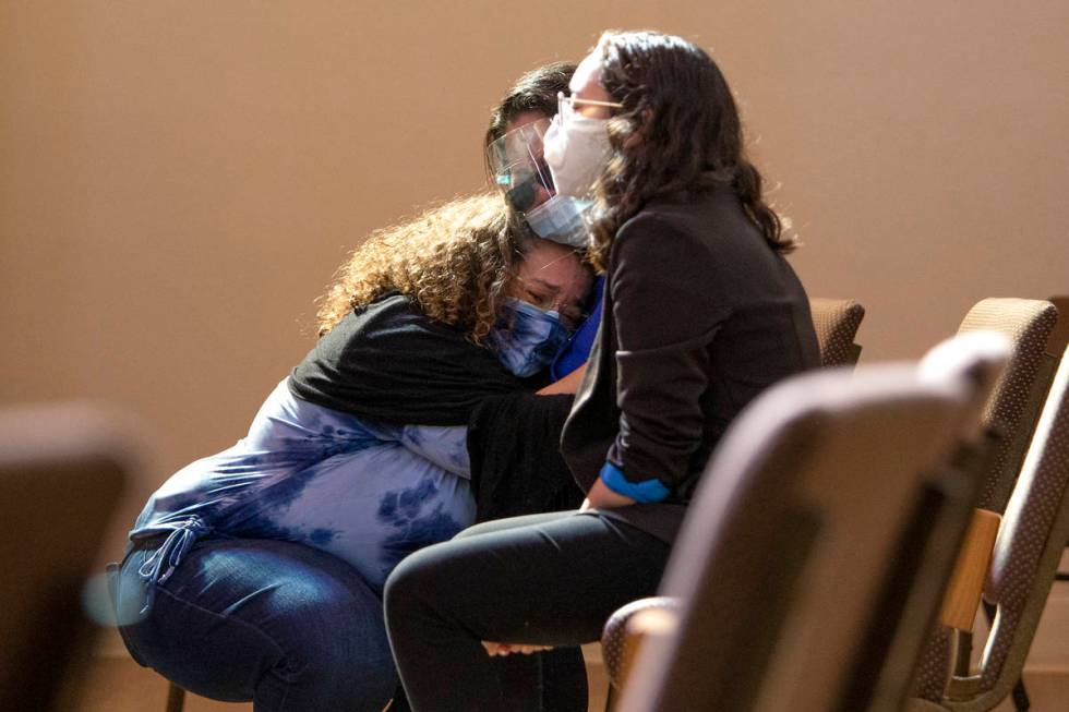 Klaudia Morales embraces her mother-in-law during the viewing for her stepson, Skyler Morales, ...