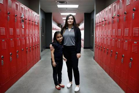 Daniela Lopez, a high school senior at Mountain View Christian School, right, poses for photo w ...