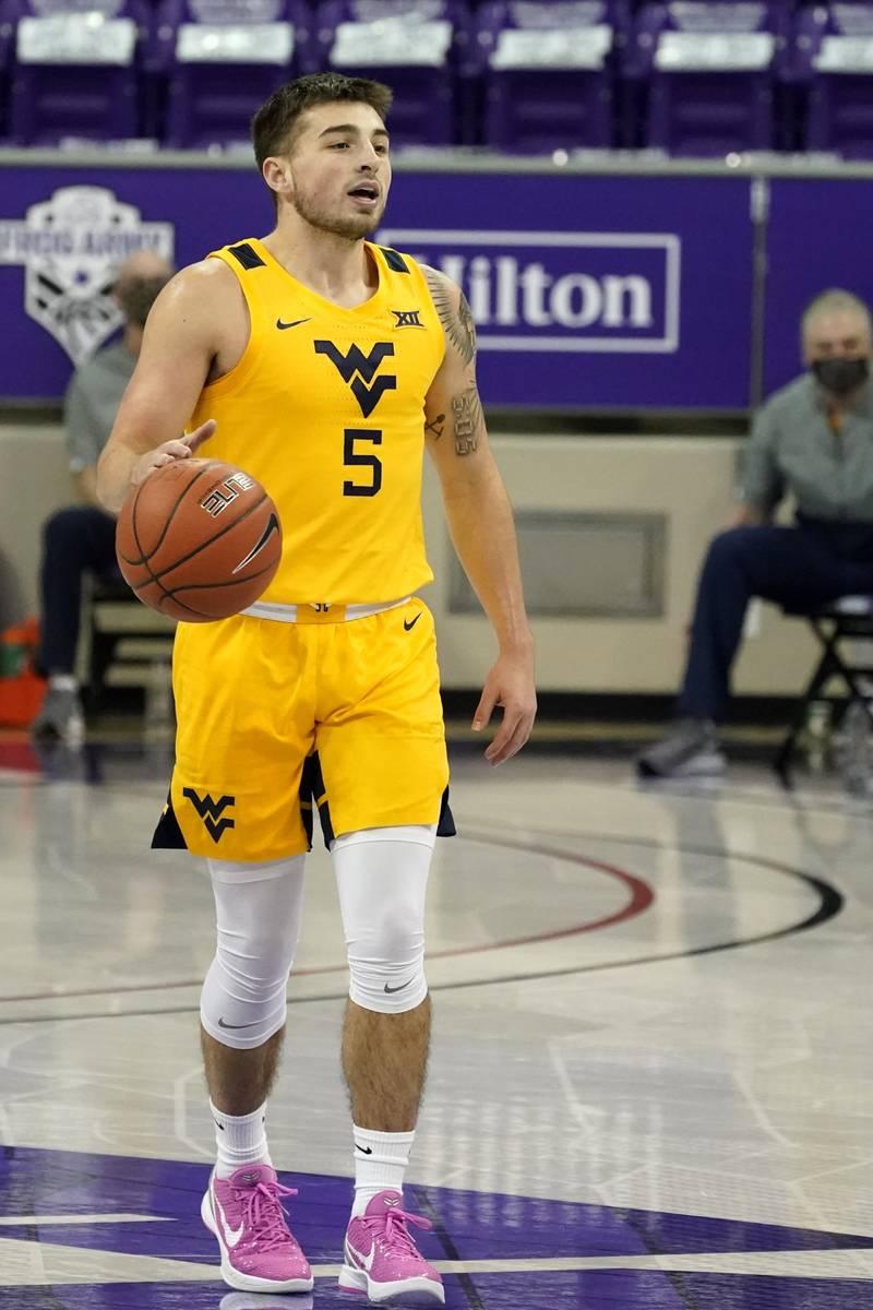 West Virginia guard Jordan McCabe handles the ball during an NCAA college basketball game again ...