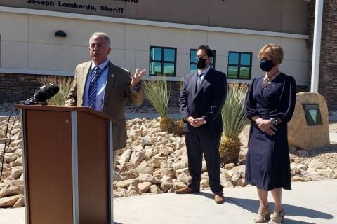 Clark County Sheriff Joe Lombardo, left, speaks alongside Commissioner Michael Naft, center, an ...