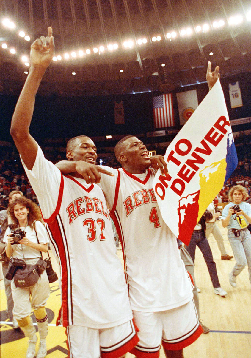 UNLV forwards Stacey Augmon, left, and Larry Johnson celebrate their win over Loyola Marymount ...