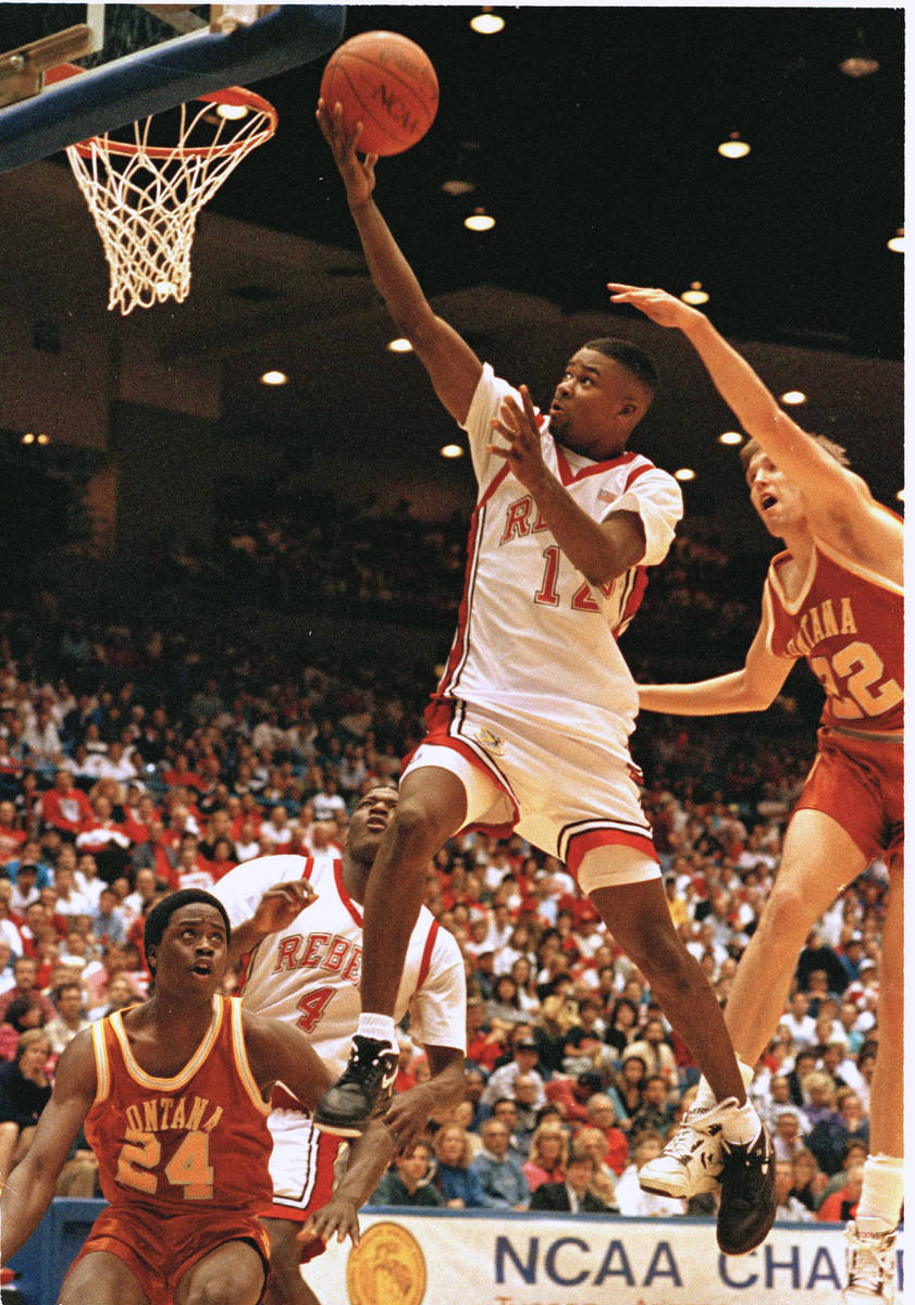 FILE - In this March 16, 1991, file photo, UNLV's guard Anderson Hunt goes past Montana's Roger ...