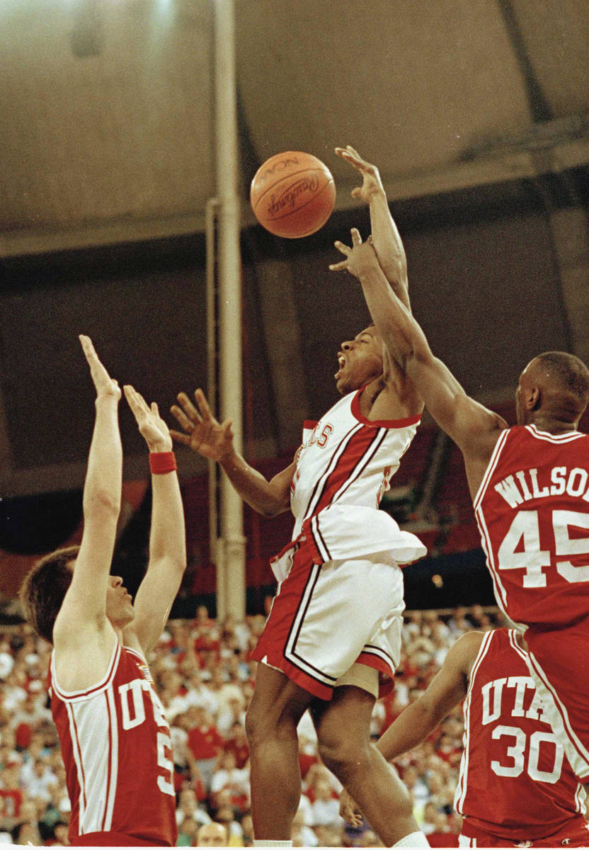 UNLV's Greg Anthony (50) goes to the basket between Utah's Josh Grant (5) and Byron Wilson (45) ...