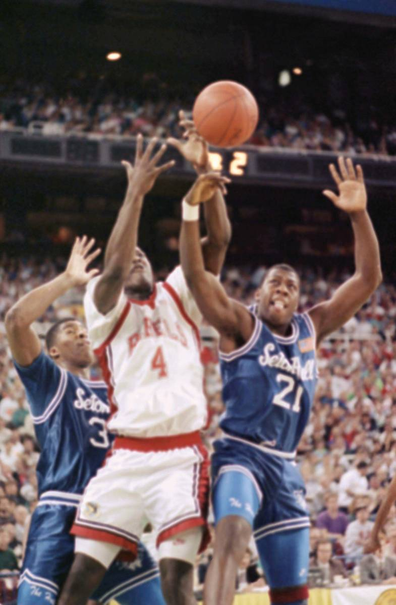 Nevada-Las Vegas Larry Johnson (4) battles Seton Hall's Anthony Avent (32) and Jerry Walker (21 ...