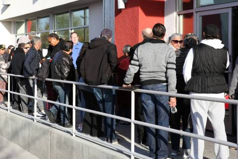 People wait in line at One-Stop Career Center on March 16, 2020, in Las Vegas. (Bizuayehu Tesfa ...