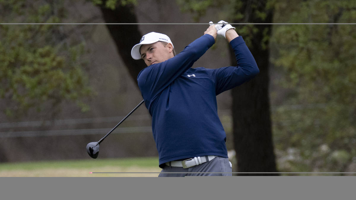 Jordan Spieth follows through on his swing on the 2nd hole during the third round of the Valero ...