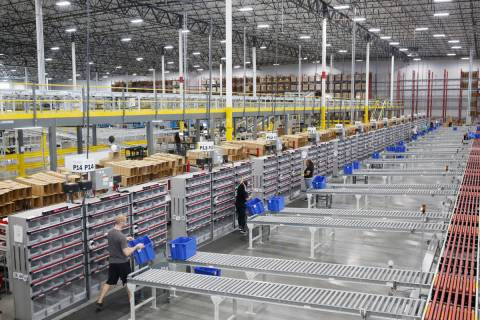 Warehouse workers sort products at the Sephora distribution center in North Las Vegas on Friday ...