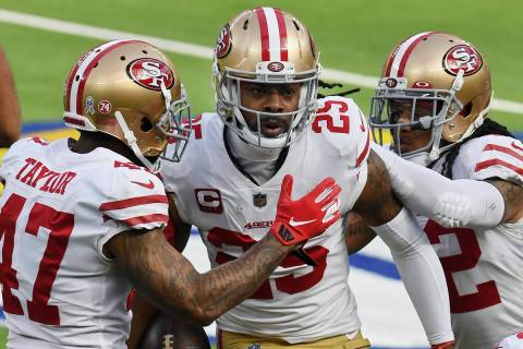 San Francisco 49ers cornerback Richard Sherman (25) is greeted by teammates after Sherman inter ...