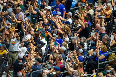 "Las Vegas Aviators fans cheer for the ""Simba Cam"" while battling the Sacramento River ..."