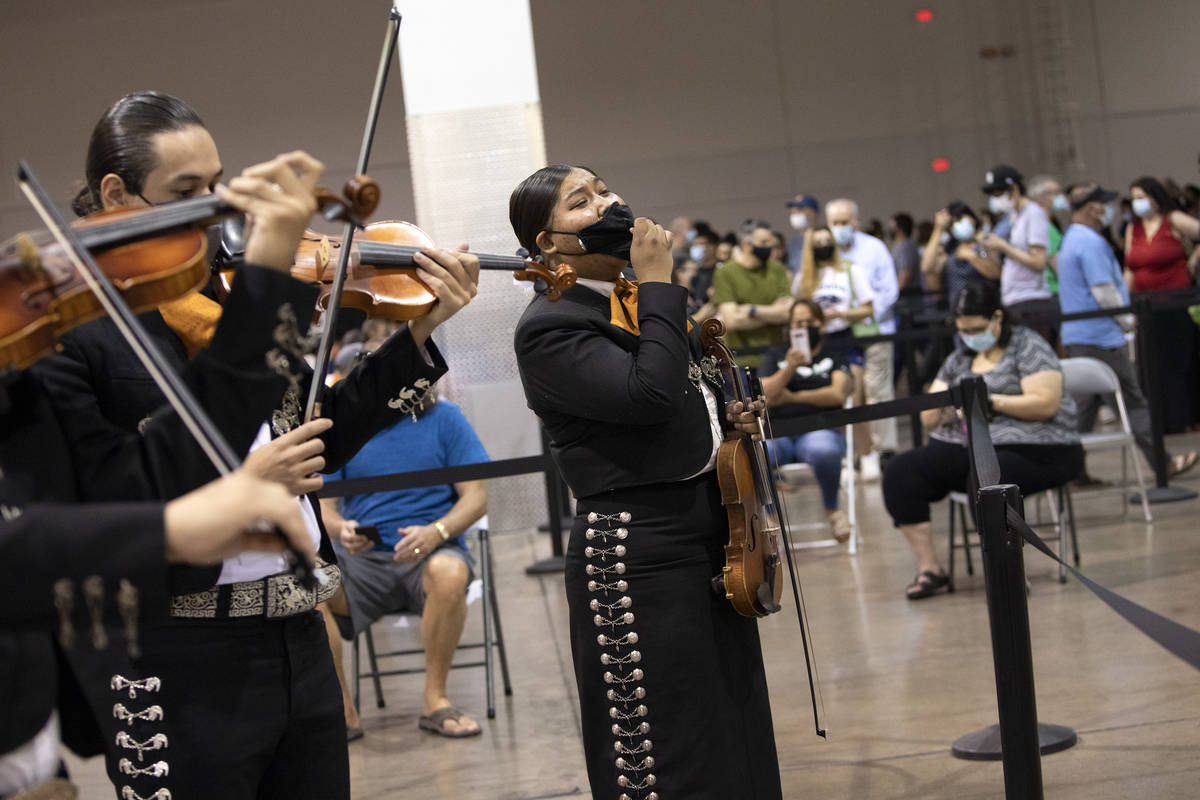 Cristina Lopez, center, sings as part of Mariachi Nuestras Raices during their performace at th ...