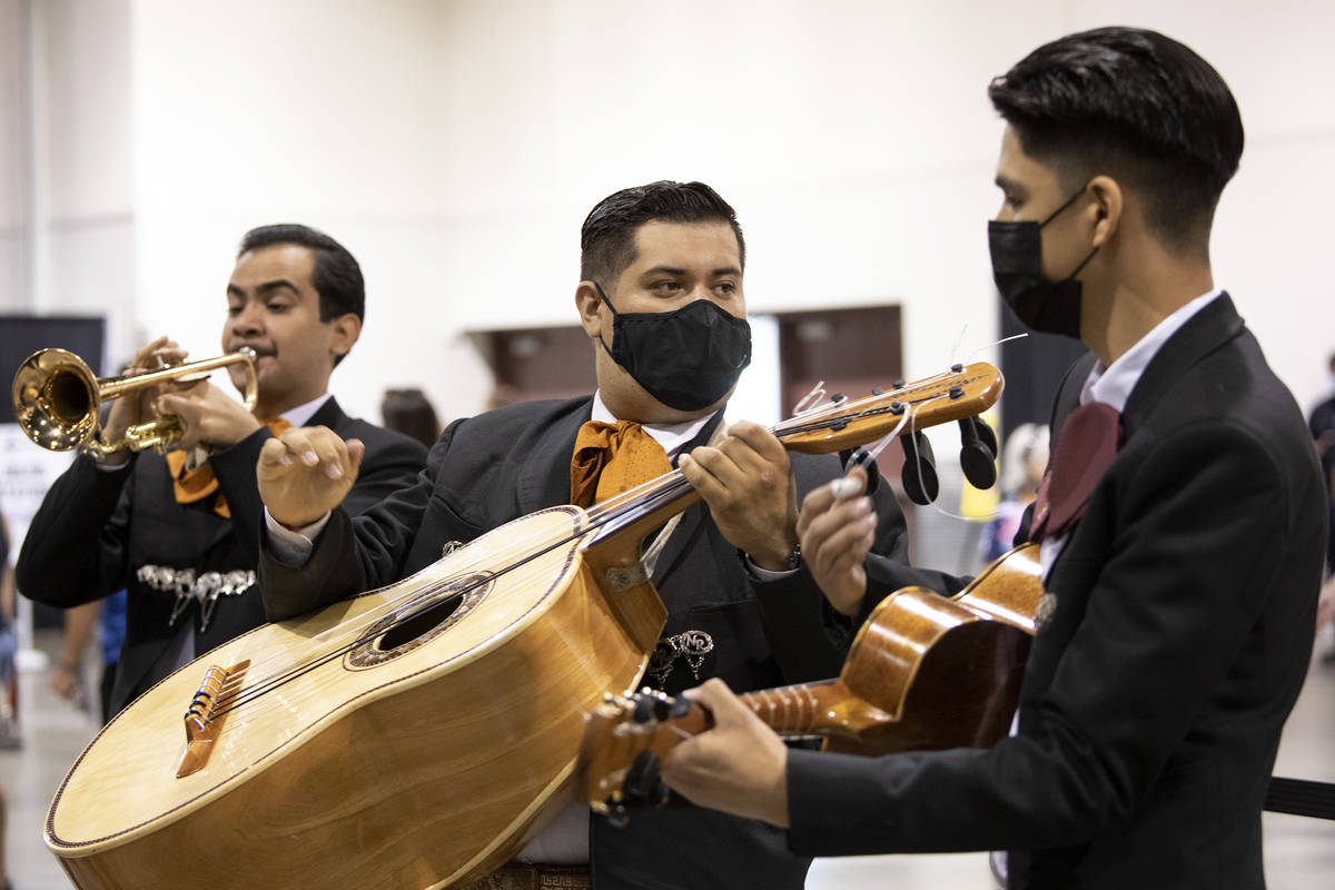 Andres Villalobos, Armulfo Reyna and Ceasar Arciga perform as part of Mariachi Nuestras Raices ...