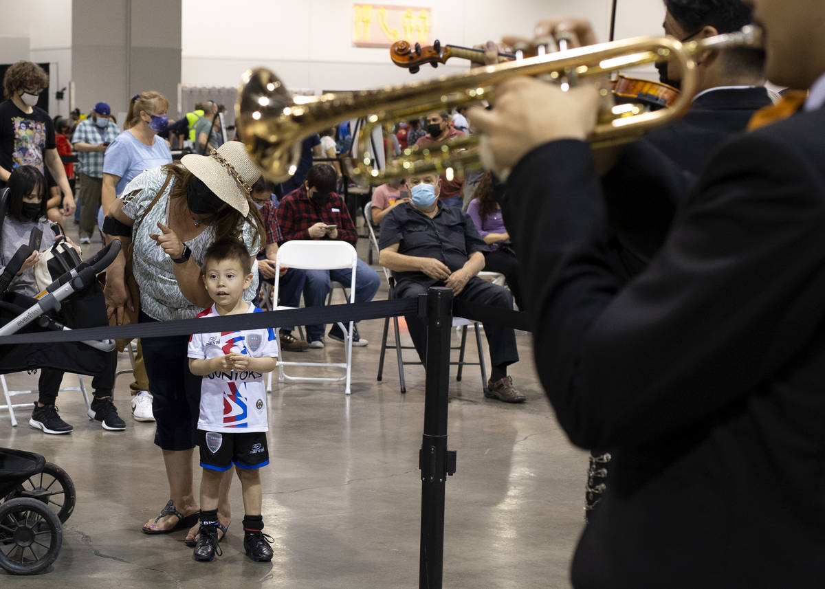 Iker Vasquez, 4, and his grandmother Irma Valdivieso watch Mariachi Nuestras Raices's performan ...