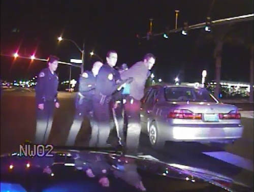 Nevada Highway Patrol video from 2010 shows officers helping handcuffed motorist Adam Greene up ...