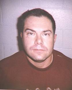 A mug shot of Henderson Police Sgt. Michael Gillis taken after his 2006 domestic violence arres ...